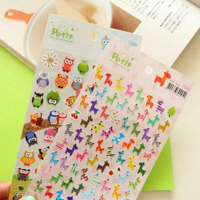 Hand Holding Cartoon Animal Stickers Owls and Giraffes