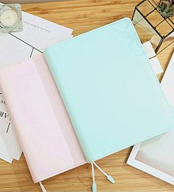 Blue and pink faux leather pastel refillable journal flatlay