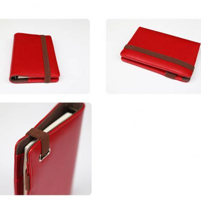 Red faux leather refillable journal with brown strap closure in 3 perspectives
