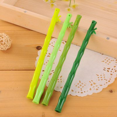 Green bamboo stick gel pens 4 assorted colors flatlay wooden box