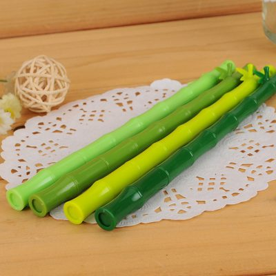 Green bamboo stick gel pens 4 assorted colors flatlay