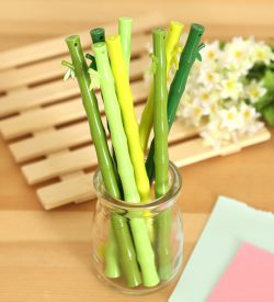 Green bamboo stick gel pens assorted colors in glass pen holder