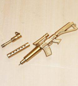 Gold Ak 47 gel pen disassembled flatlay