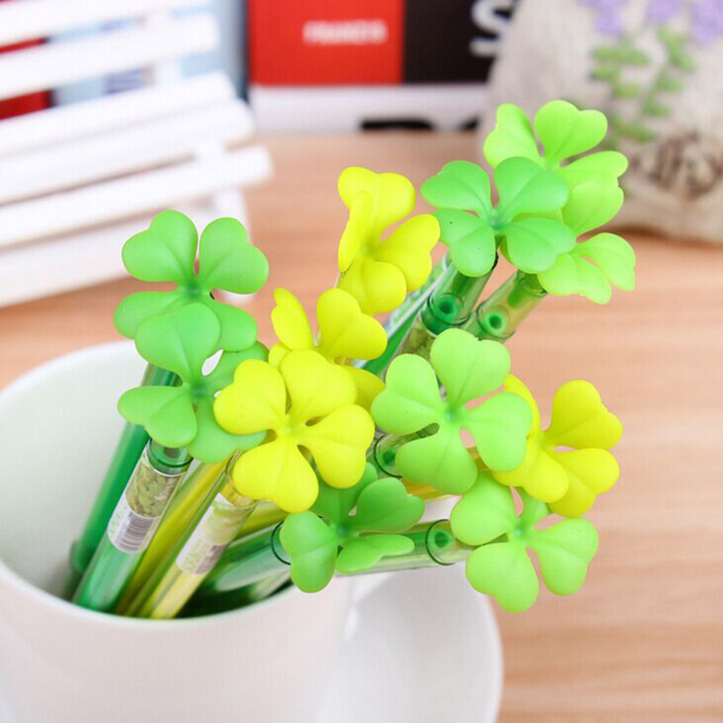 Bunch of four-leaf clover gel pens in pen holder closeup