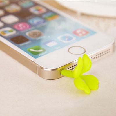 Four leaf clover topper in iphone headphone jack