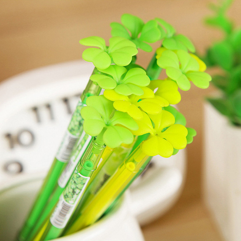 Four-leaf clover gel pens closeup in pen holder