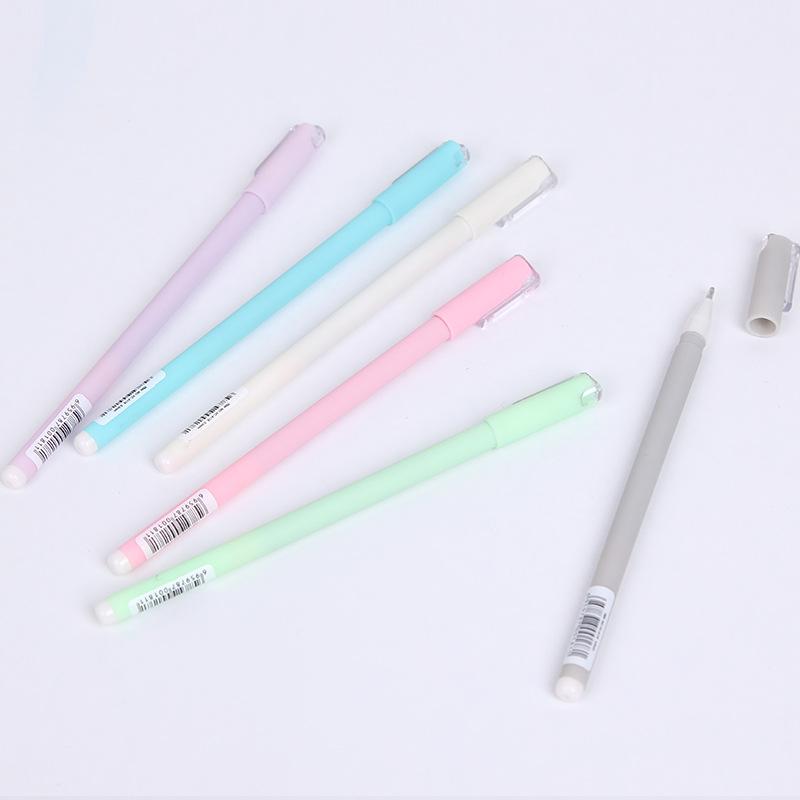 flatlay of purple blue white pink green gray pastel gen pens