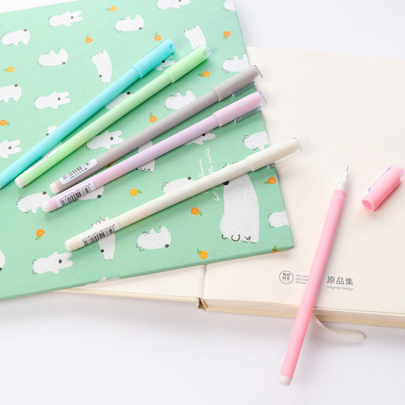 Flatlay of pastel gel pens pink white purple grey blue green