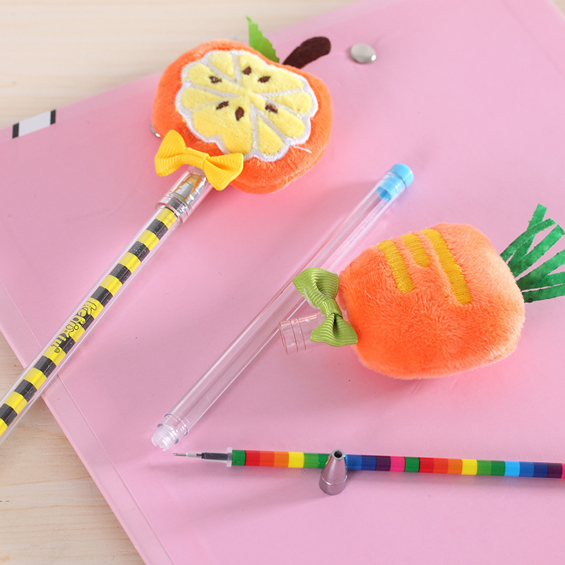 Plush fruit gel pen flatlay pumpkin carrot uncapped