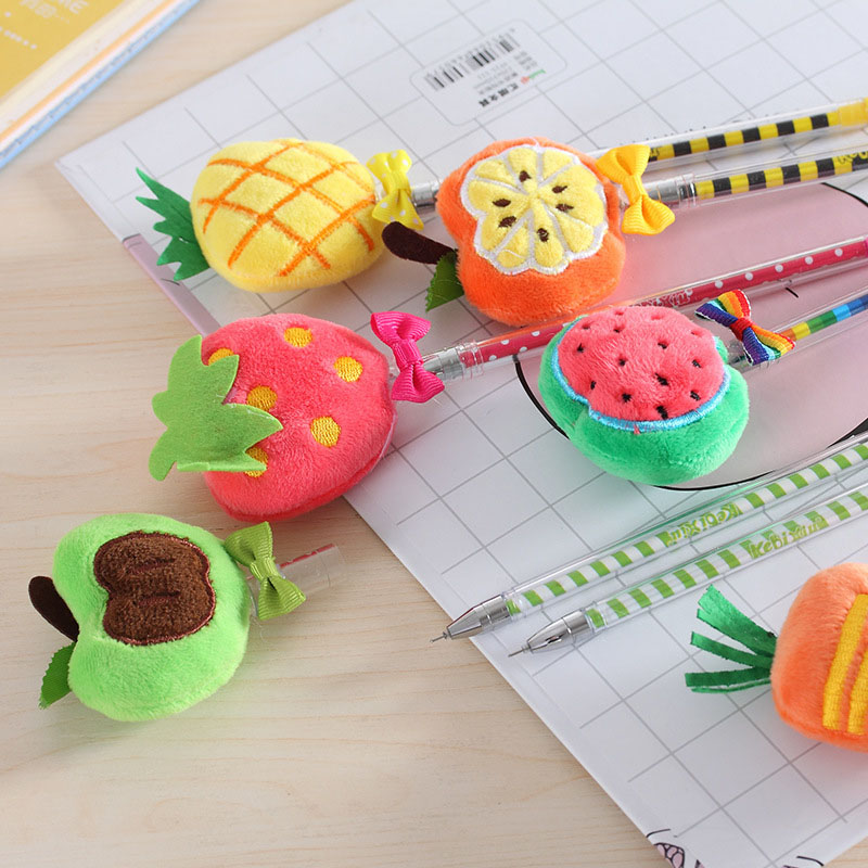Plush fruit gel pen flatlay apple pineapple strawberry watermelon pumpkin