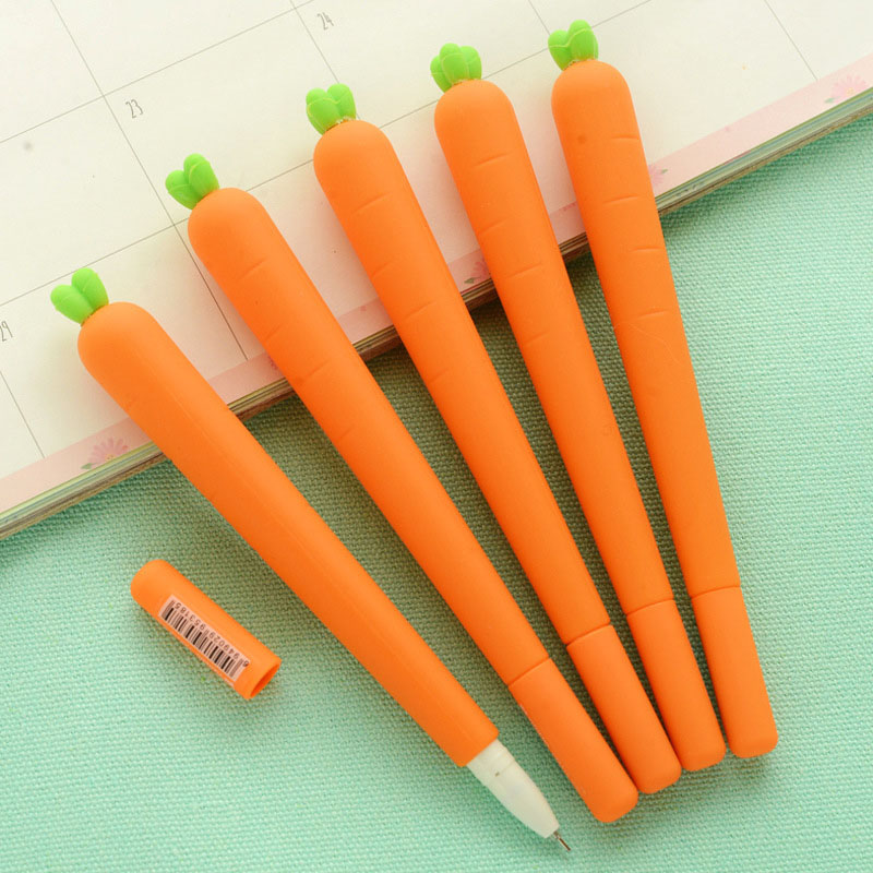 Flatlay of carrot gel pens open cap