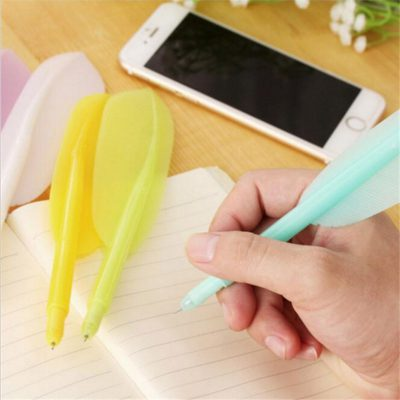 Pen holding cyan quill pen with 3 color options on notebook