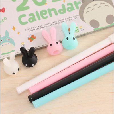 Pastel bunny gel pen 4 color options closeup blue white black pink topper