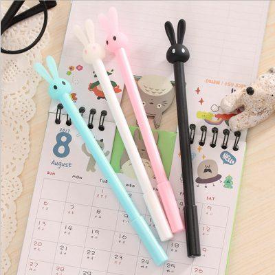 Pastel bunny gel pen 4 color options closeup blue white black pink on calendar