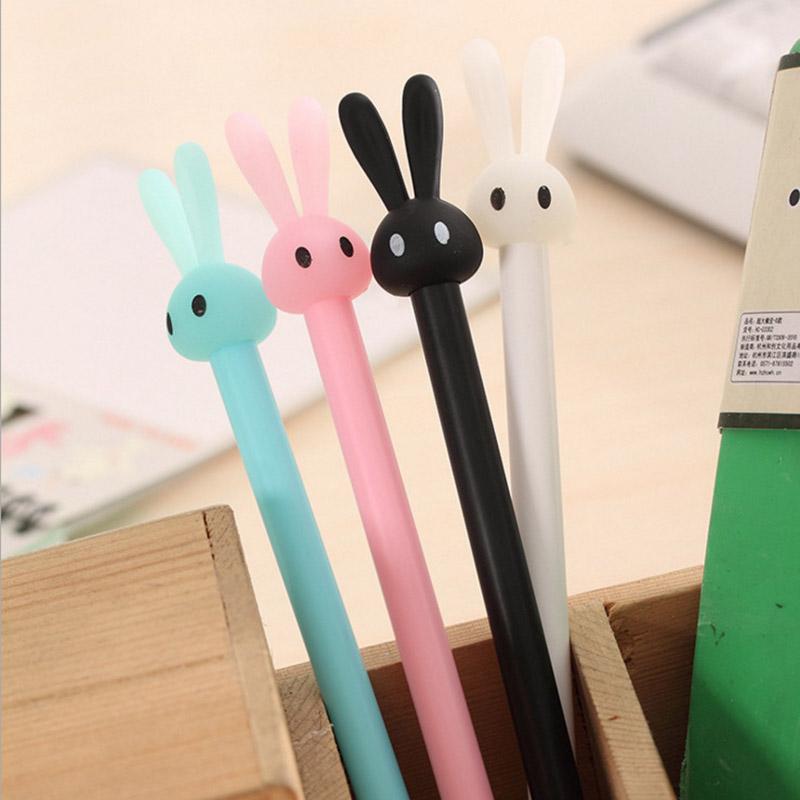 Pastel bunny gel pen 4 color options closeup blue white black pink in pen holder