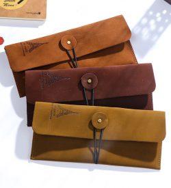 Vintage faux leather eiffel tower pencil case 3 options elastic closure envelope style flatlay