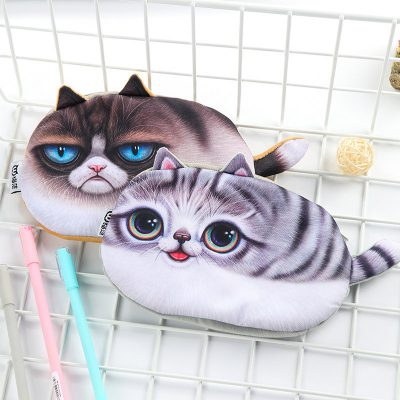 Two plush cat pencil cases with two pens in metal cage box