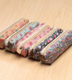 Floral and lace pencil case 5 options brown blue pink black on hardwood