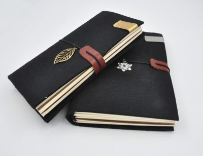 Black handmade felt refillable journal with silver snowflake and gold leaf charms stainless steel and brass metal pen holder clip