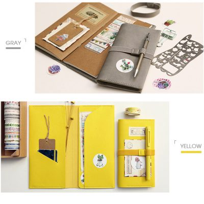 Faux leather refillable notebook organizer demo display with pens bookmarks stickers stencils paperclip open layout flatlay gray yellow