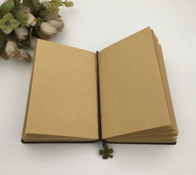Basic vintage leather journal with four leaf clover charm bookmark open notebook kraft inner paper