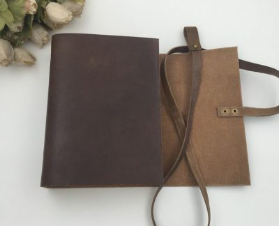 Dark brown vintage leather wrap journal with open flap