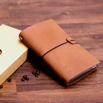 Light brown faux leather refillable journal with elastic closure one notebook