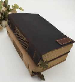Basic vintage leather journal two notebooks stacked earth yellow dark brown