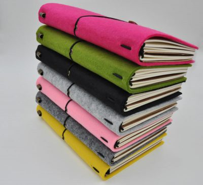 Handmade felt refillable journal pink green yellow grey 7 notebooks stacked