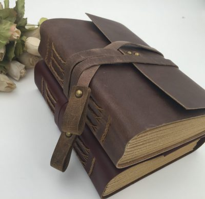 Vintage leather wrap journal two notebooks stacked dark and bright brown