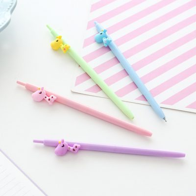 Pastel Giraffe Ballpoint Pens Four Colors Flat Lay On Table