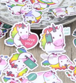 Rainbow Unicorn Stickers On A Table