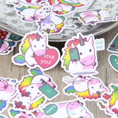 Rainbow Unicorn Stickers On A Table
